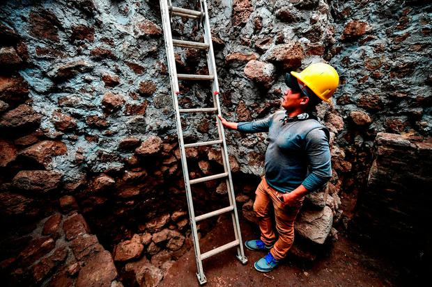A man at work in the pyramid in Cuernavaca, Mexico. Photo: Getty Images