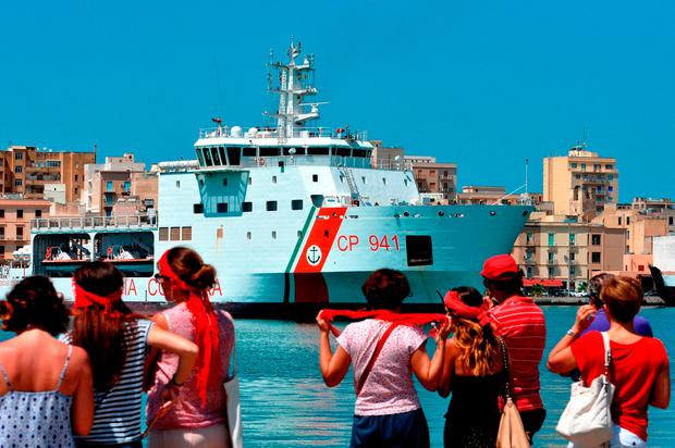 The Italian coast guard vessel sails into port in Sicily. Photo: Getty Images