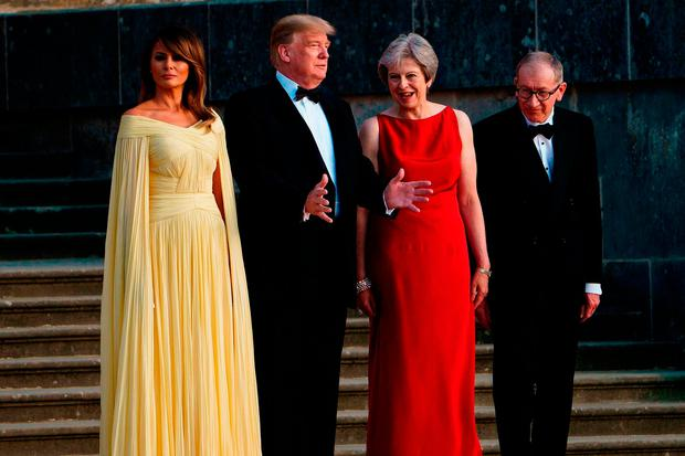 US President Donald Trump, British Prime Minister Theresa May, US First Lady Melania Trump and Philip May watch the bands of the Scots, Irish and Welsh Guards perform a ceremonial welcome ahead of a black-tie dinner at Blenheim Palace last night. Photo: Getty Images