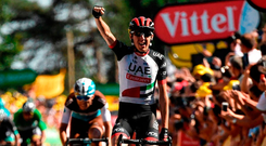 Dan Martin celebrates as he crosses the line to take yesterday's sixth stage of the Tour De France. Photo: Getty Images