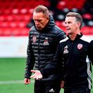 A dejected Derry City manager Kenny Shiels and assistant manager Hugh Harkin. Photo: Oliver McVeigh/Sportsfile
