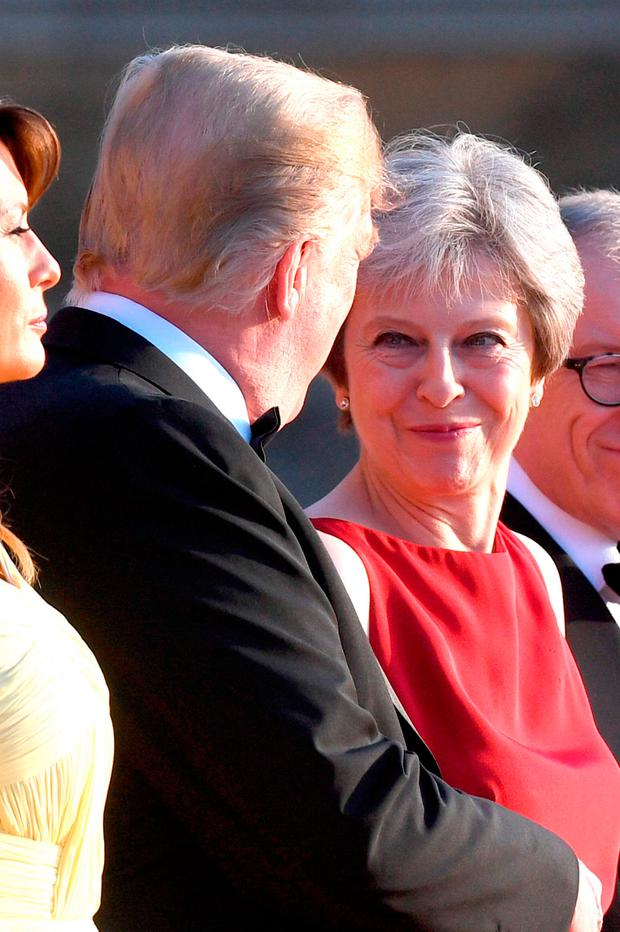 US President Donald Trump and his wife Melania are welcomed by Prime Minister Theresa May and her husband Philip May at Blenheim Palace, Oxfordshire, UK. Photo: Stefan Rousseau/PA Wire
