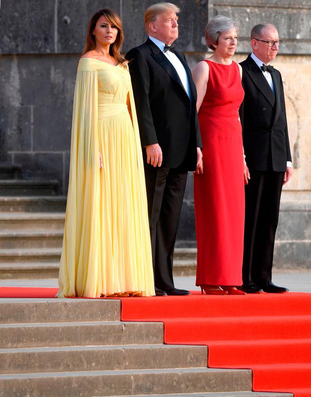 US President Donald Trump and his wife Melania are welcomed by Prime Minister Theresa May and her husband Philip May at Blenheim Palace