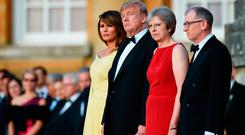 US President Donald Trump and US First Lady Melania Trump stand with Prime Minister Theresa May and her husband Philip May at Blenheim Palace, Oxfordshire, ahead of a dinner as part of his visit to the UK. Photo: Geoff Pugh/Telegraph/PA Wire
