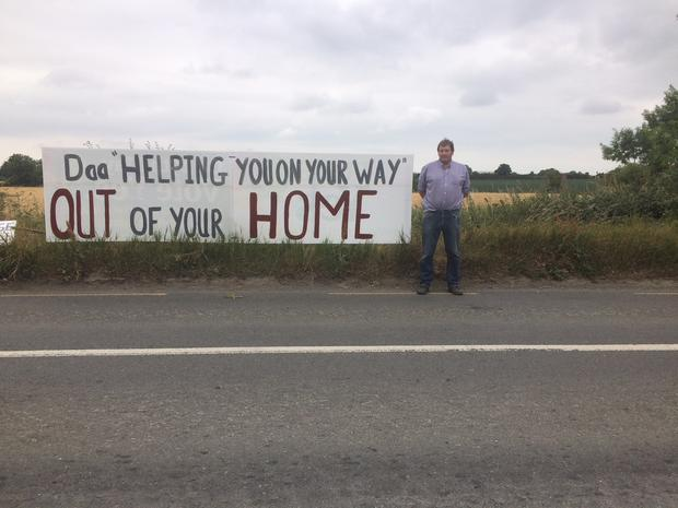 Residents staged a four hour long protest outside St Margaret's GAA club while the daa held an information meeting for those who will be affected by the new development last night.