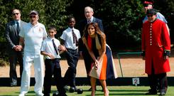 U.S. First Lady Melania Trump and Philip May, the husband of Britain's Prime Minister Theresa May, take part in a game of bowls with veterans and schoolchildren during a visit to the Royal Hospital Chelsea in London, Britain, July 13, 2018. REUTERS/Yves Herman