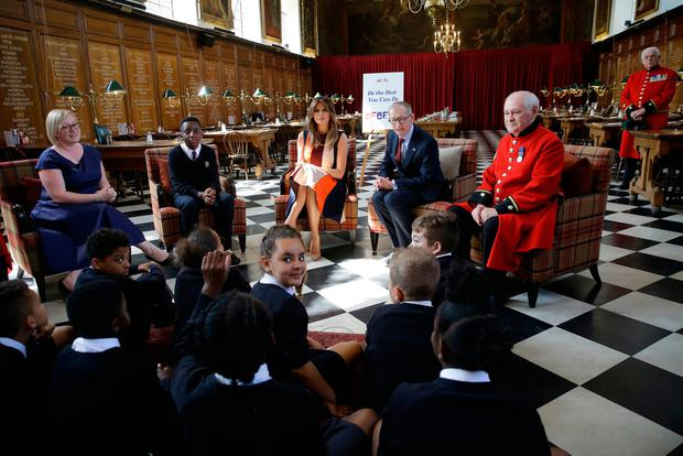 Philip May (second right), the husband of Prime Minister Theresa May, listens as US First Lady Melania Trump (centre), take questions from school pupils during a visit to the Royal Hospital, Chelsea, London. PRESS ASSOCIATION Photo. Picture date: Friday July 13, 2018. Photo: Luca Bruno/PA Wire