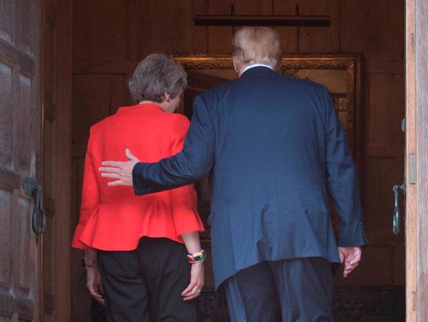 Prime Minister Theresa May and US President Donald Trump walk through the doors at Chequers, after he arrived for talks at her country residence in Buckinghamshire. PRESS ASSOCIATION Photo. Picture date: Friday July 13, 2018. See PA story POLITICS Trump. Photo credit should read: Stefan Rousseau/PA Wire