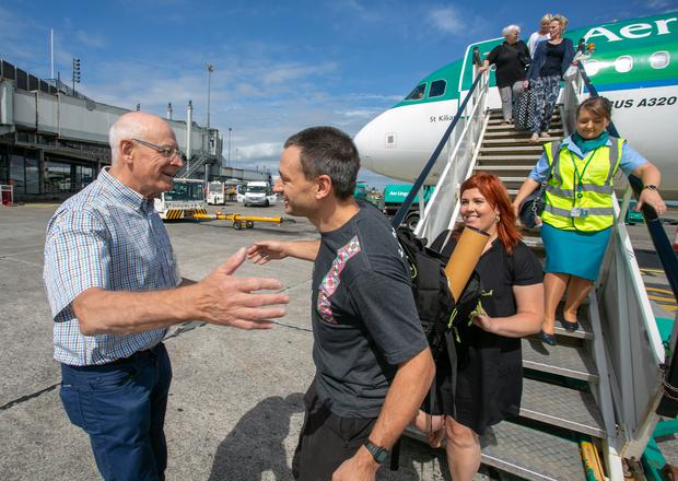Pictured is Jim Warny being greeted by his dad Rene Warny after he landed in Shannon Airport this morning. Pic Arthur Ellis.