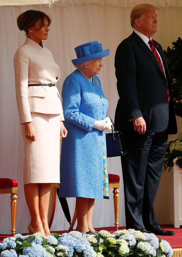 US President Donald Trump and the First Lady Melania Trump are met by Britain's Queen Elizabeth as they arrive for tea at Windsor Castle: Reuters/Kevin Lamarque