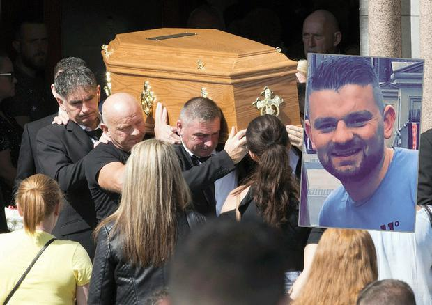 Patrick O'Connor (inset) was remembered as a 'good family man' at his funeral today
