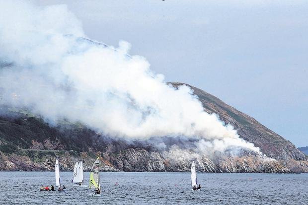 Smoke pours from the gorse fire which caused disruption to rail services in Co Wicklow. Photo: Sam Boal / RollingNews.ie