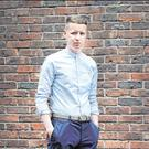 Ryan Nugent wearing a blue grandad collar shirt from Farrah (€75), navy Penguin trousers (€70), a grey Ted Baker belt (€39) and navy Kurt Geiger shoes (€70) all from Arnotts Menswear. Photo: Steve Humphreys