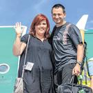 Jim Warny was greeted by fiancée Asia Mania after he landed in Shannon Airport. Photo: Arthur Ellis