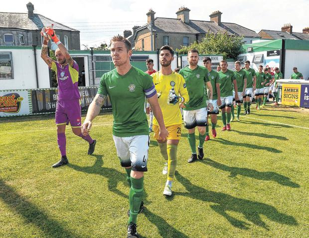 Bray Wanderers captain Conor Kenna leads out his team