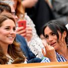 Tennis - Wimbledon - All England Lawn Tennis and Croquet Club, London, Britain - July 14, 2018. Britain's Catherine the Duchess of Cambridge and Meghan the Duchess of Sussex watch Spain's Rafael Nadal continue his semi final match against Serbia's Novak Djokovic, which was suspended yesterday, after running late. REUTERS/Toby Melville