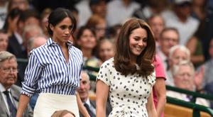Britain's Catherine, Duchess of Cambridge, (R) and Britain's Meghan, Duchess of Sussex (L) take their seats in the Royal box on Centre Court before watching Serbia's Novak Djokovic play against Spain's Rafael Nadal during the continuation of their men's singles semi-final match on the twelfth day of the 2018 Wimbledon Championships at The All England Lawn Tennis Club in Wimbledon, southwest London, on July 14, 2018. (Photo by Oli SCARFF / AFP) / RESTRICTED TO EDITORIAL USE (Photo credit should read OLI SCARFF/AFP/Getty Images)