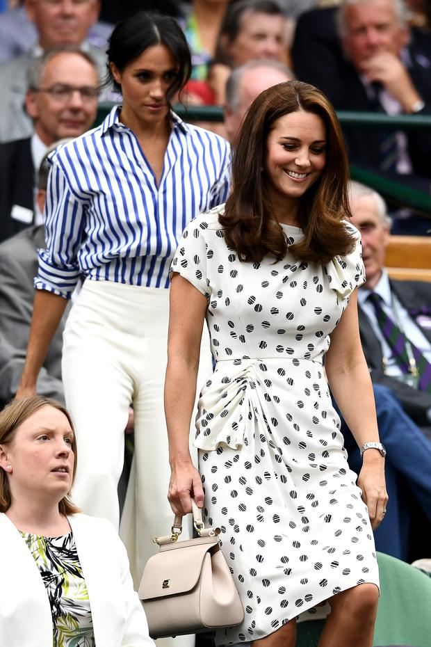 Catherine, Duchess of Cambridge (R) and Meghan, Duchess of Sussex attend day twelve of the Wimbledon Lawn Tennis Championships at All England Lawn Tennis and Croquet Club on July 14, 2018 in London, England. (Photo by Clive Mason/Getty Images)