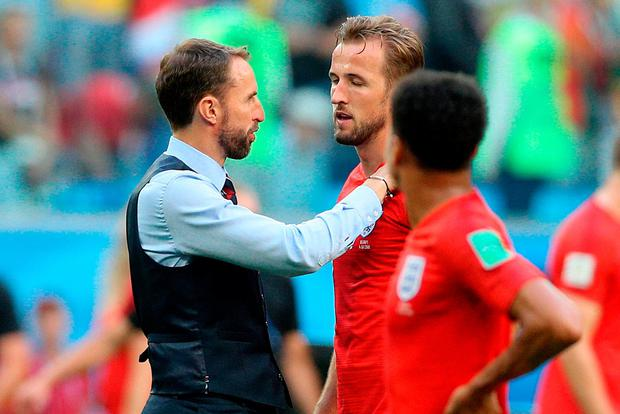 England manager Gareth Southgate (left) consoles Harry Kane after the FIFA World Cup third place play-off match at Saint Petersburg Stadium