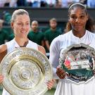 Germany's Angelique Kerber and Serena Williams of the U.S. hold their trophies after Kerber won the women's singles final. REUTERS/Toby Melville