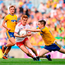 Peter Harte of Tyrone is tackled by Cathal Compton of Roscommon.