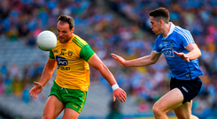 Michael Murphy of Donegal in action against Brian Fenton of Dublin.