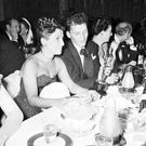 In a crowded Ciro's in LA in 1946, Frank Sinatra glances at the Oscar he won for 'The House I Live In' as his wife Nancy looks on. Photo: AP