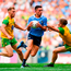 Niall Scully of Dublin escapes the tackle of Hugh McFadden of Donegal.
