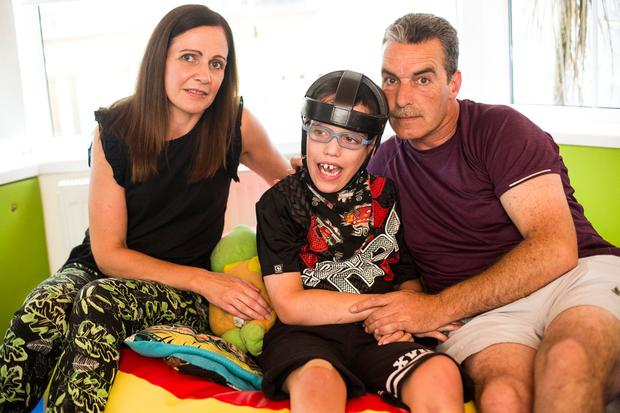 Sinead and Keith Tighe with their son Daniel, who requires constant care. Photo: Mark Condren