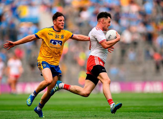 Tyrone's Matthew Donnelly against Roscommon's Gary Patterson. Photo: David Fitzgerald/Sportsfile