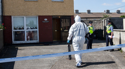 Scene: Gardai at the address in Rowlagh Green, Clondalkin, where 74-year-old Tony Tims lost his life. Photo: Mark Condren