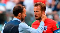 England's coach Gareth Southgate (L) talks to England's forward Harry Kane after the game Photo: AFP/Getty