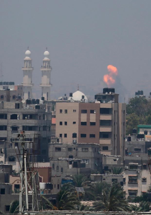 An explosion is seen following Israeli strikes in Gaza Strip July 14, 2018. REUTERS/Ibraheem Abu Mustafa