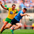 Brian Howard of Dublin in action against Michael Murphy of Donegal