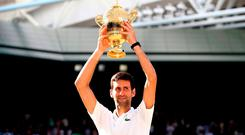 Novak Djokovic with the trophy after winning the Gentlemen's singles final on day thirteen of the Wimbledon Championships at the All England Lawn Tennis and Croquet Club, Wimbledon. PRESS ASSOCIATION Photo. Picture date: Sunday July 15, 2018. See PA story TENNIS Wimbledon. Photo credit should read: John Walton/PA Wire. RESTRICTIONS: Editorial use only. No commercial use without prior written consent of the AELTC. Still image use only - no moving images to emulate broadcast. No superimposing or removal of sponsor/ad logos. Call +44 (0)1158 447447 for further information.