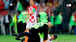 A pitch invader is tackled to the ground by security during the FIFA World Cup Final at the Luzhniki Stadium, Moscow.