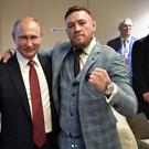 Conor McGregor pictured with Russian President Vladimir Putin at the Luzhniki Stadium for the World Cup Final: Instagram