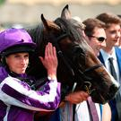 Ryan Moore with US Navy Flag after winning the Darley July Cup Stakes during day three of The Moet & Chandon July Festival at Newmarket. Photo: Joe Giddens/PA