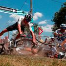 Chris Froome crashes over his team-mates as the Tour de France peloton hit the cobbles. Photo: Reuters