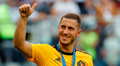 Belgium's Eden Hazard celebrates with a third place medal after the match against England. Chelsea are reported to be ready to reject approaches from Real Madrid and Barcelona for the player. Photo: Toru Hanai/Reuters