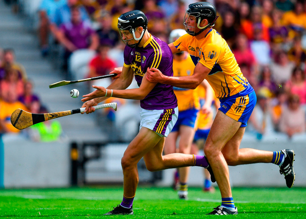 Wexford's Jack O'Connor in action against Cathal Malone of Clare. Photo: Brendan Moran/Sportsfile