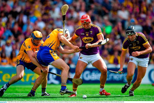 Lee Chin, centre, and Liam Óg McGovern of Wexford in action against Seadna Morey, left, and Patrick O'Connor of Clare. Photo: Brendan Moran/Sportsfile