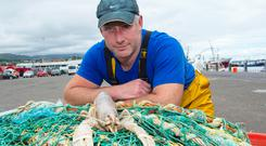Donagh O'Connor with a rare female white lobster caught off Mizen Head, Cork. Photo: Niall Duffy
