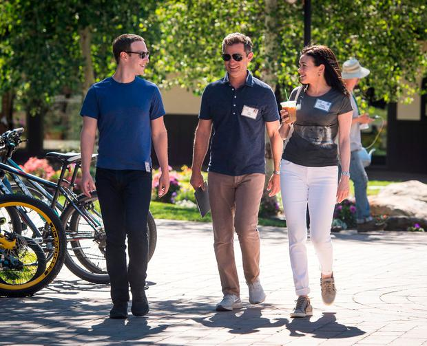 Facebook CEO Mark Zuckerberg, left, with Dan Rose, VP of partnerships and platform marketing, and chief operating officer Sheryl Sandberg at the Allen & Co Media and Technology Conference in Sun Valley, Idaho. The tech giant has been accused of 'privacy risks'. Photo: David Paul Morris/Bloomberg