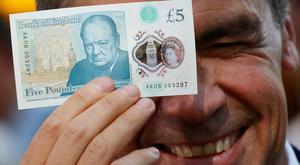 Bank of England governor Mark Carney launching a new five pound note featuring a portrait of Winston Churchill. Photo: Stefan Wermuth - WPA Pool/Getty Images