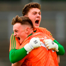 Mayo goalkeeper Paddy O'Malley celebrates with team-mate Adam Byrne, front, at the final whistle. Photo: Piaras Ó Mídheach/Sportsfile
