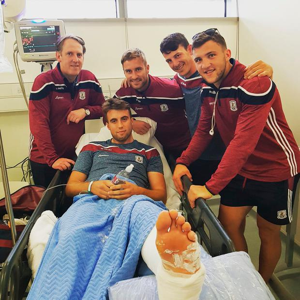 'He still manages a smile.. Speedy recovery bro @PaulC225 no doubt you'll be back stronger! #gaillimhabú' – Damien Comer posted this picture on social media as the Galway players visit Paul Conroy – who suffered a double leg fracture – in hospital