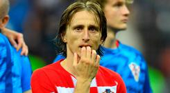Croatia's Luka Modric looks dejected after the match. REUTERS/Dylan Martinez