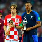 Croatia's Luka Modric poses with the World Cup Best Player Award as France's Kylian Mbappe poses with the World Cup Best Young Player Award REUTERS/Dylan Martinez