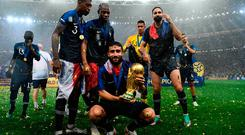 France's midfielder Nabil Fekir holds the World Cup trophy